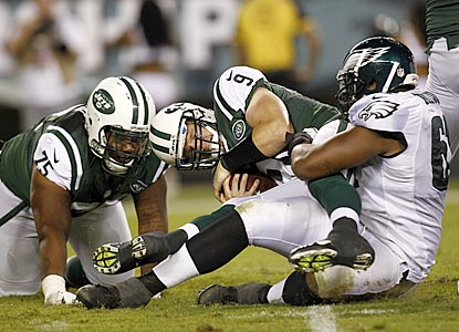 After the Jets finally hit paydirt, the rest of the game goes something like this. Here, Monte Taylor sacks backup Matt Simms.  (Getty Images)