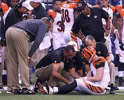 The Bengals holds their collective breath as Andy Dalton is examined. Dalton is expected to be fine for Week 1.  (US Presswire)