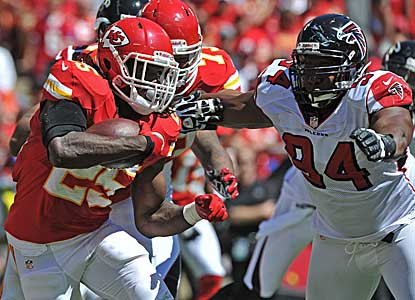 Jamaal Charles looks for running room against the Falcons. Charles runs for 87 yards, but it's not enough for Kansas City.  (Getty Images)