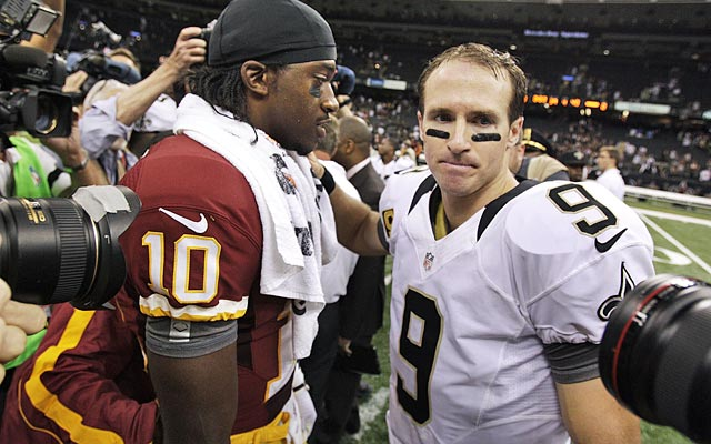 Robert Griffin III outplays the Saints' $100 million man, record-setting Drew Brees. (AP)