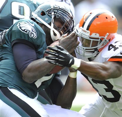 Michael Vick endures a tough opener (four interceptions) in Cleveland, but still leads the Eagles to victory.  (US Presswire)