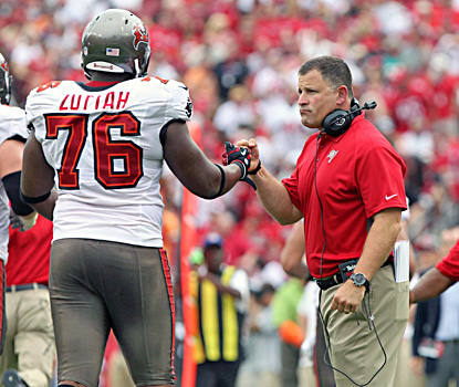 Greg Schiano, making his debut as Bucs coach, congratulates Jeremy Zuttah after a touchdown. (US Presswire)