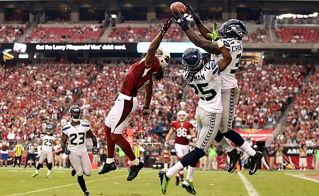 Kam Chancellor breaks up a pass intended for Larry Fitzgerald. (Getty Images)