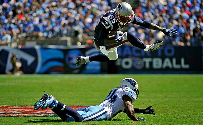 Brandon Lloyd jumps over Titans S Coty Sensabaugh during their season opener. (Getty Images)