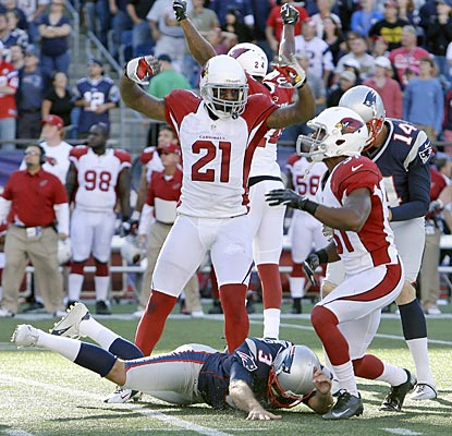 Patrick Peterson and the Cardinals celebrate their victory over a fallen Stephen Gostkowski after his missed field goal.  (AP)