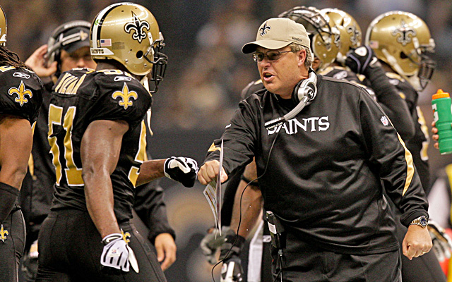 Williams says Jonathan Vilma (left) offered $10,000 to knock Brett Favre out of a game in 2009. (US Presswire)