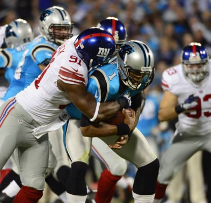 Justin Tuck and the Giants defense keep Cam Newton and the Panthers offense in check.  (US Presswire)