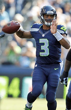 Russell Wilson will have to be on his toes against the Packers' dangerous pass rush. (AP)