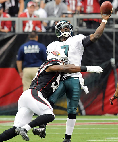 Michael Vick, harassed all afternoon, is nearly sacked by Daryl Washington.  (Getty Images)