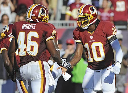 Rookies Alfred Morris (113 rushing yards) and Robert Griffin III (323 passing yards) help Washington squeak past Tampa Bay.  (AP)