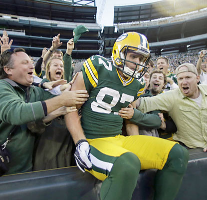 Jordy Nelson enjoys the Lambeau Leap after he scores the go-ahead touchdown for the Packers late in the fourth quarter. (AP)