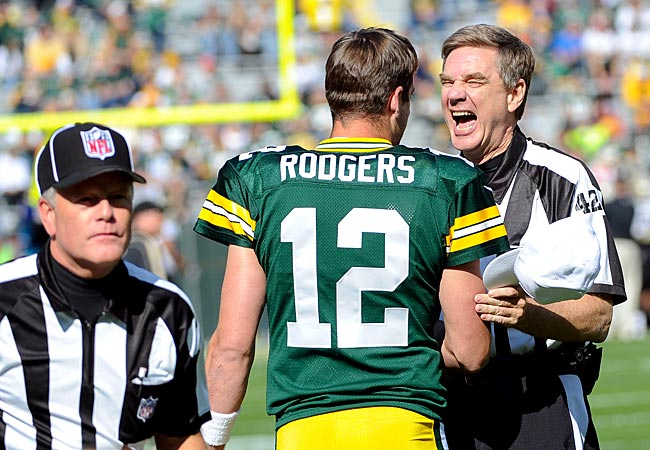 Referee Jeff Triplette laughs with Aaron Rodgers before game against the Saints. (US Presswire)