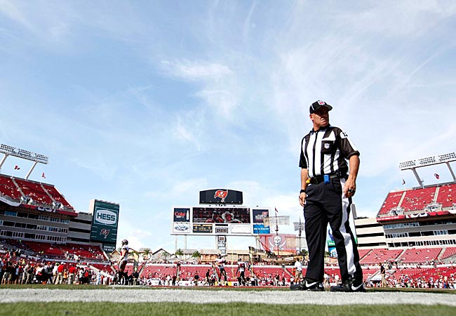 An official stands on the field prior to the Buccaneers-Redskins game. (US Presswire)