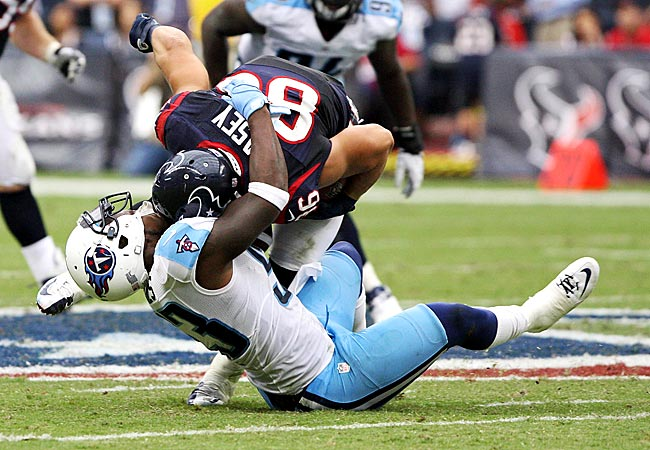 Titans LB Zac Diles makes a tackle on Texans FB James Casey. (US Presswire)