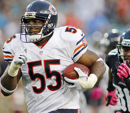 Lance Briggs and the Bears' defense yield just three points and finish with two defensive TDs, two picks and three sacks. (US Presswire)