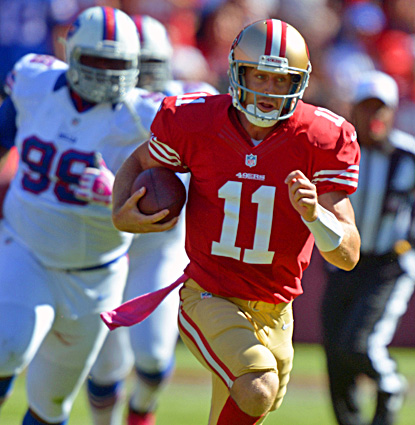 San Francisco quarterback Alex Smith rushes for a 24-yard gain in the second quarter against the Bills. (US Presswire)