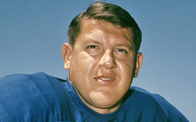 Karras became a film actor and a TV star after a 12-year career with the Lions. (AP)