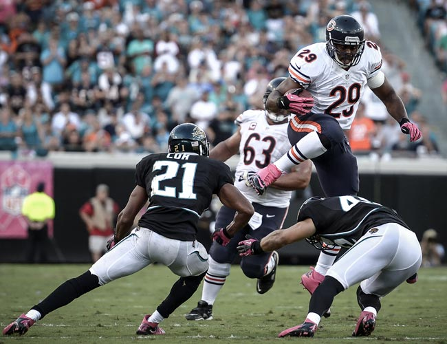 Bears RB Michael Bush leaps over Jaguars S Chris Prosinski. (US Presswire)