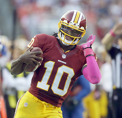 RG3 not only runs for 138 yards and throws for 182 more, he also helps the Skins end an eight-game skid at home. (AP)