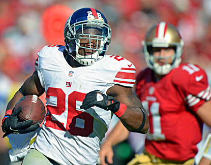 The Giants' Antrel Rolle heads upfield after picking off Alex Smith (right) in the third quarter. (US Presswire)