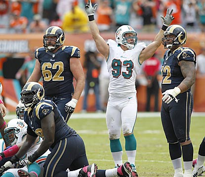 Miami's Jason Trusnik celebrates after watching St. Louis' attempt at a tying field goal fail in the final seconds. (US Presswire)