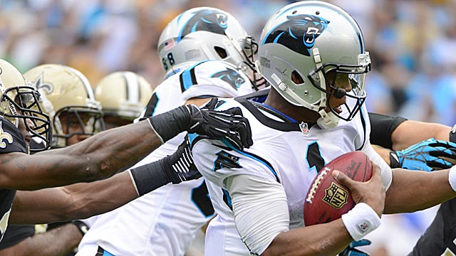 Cam Newton isn't being helped by Carolina's more pass-heavy offense. (US Presswire)