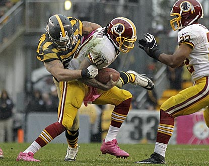 Inside linebacker Larry Foote and the swarming Steelers defense make it a long day for RG3.  (AP)