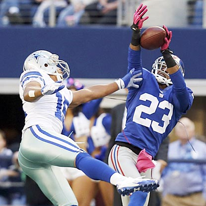 Cory Webster picks off Tony Romo for one of the Giants' four interceptions of the Dallas QB. (AP)