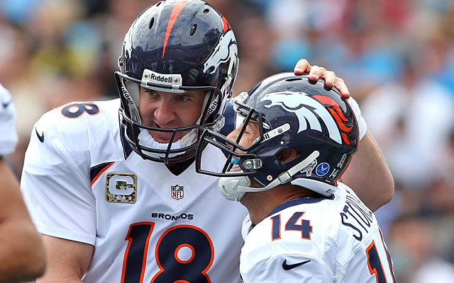 Peyton Manning celebrates with Brandon Stokley after the teammates hooked up for the milestone TD. (Getty Images)