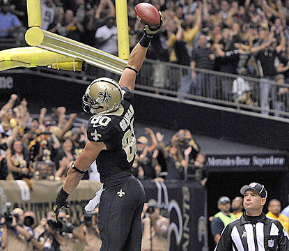Saints TE Jimmy Graham, who finishes with a career-high 146 yards, celebrates one of his touchdowns on the day. (AP)