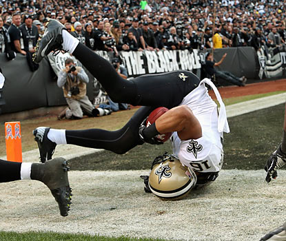 Lance Moore, who scores twice for the Saints, rolls out of the end zone after securing a touchdown grab. (Getty Images)