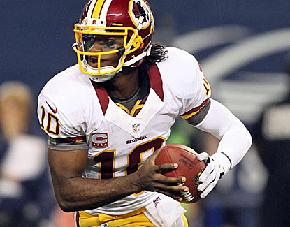Redskins rookie QB Robert Griffin III throws for 311 yards and four touchdowns against the Cowboys. (US Presswire)