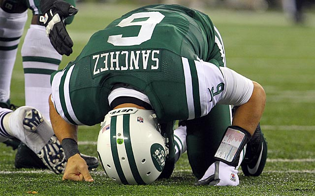 At some point during a disastrous second quarter, Mark Sanchez must have wanted to dig a hole. (US Presswire)