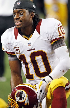 Robert Griffin III and the Redskins can't afford to lose Monday night. (AP)