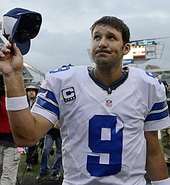 Tony Romo and the Cowboys are subdued after a huge victory. (AP)