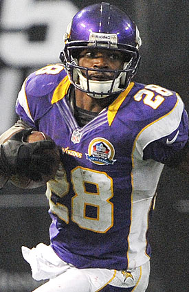 There's more than a record at stake for Adrian Peterson; he also carries the Vikings' playoff hopes Sunday. (Getty Images)