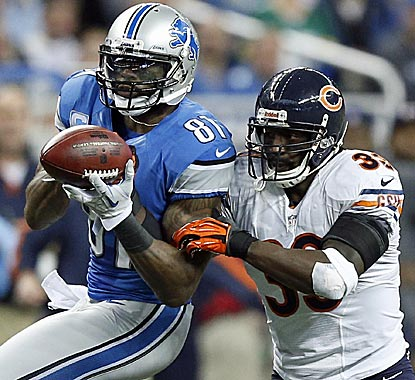Calvin Johnson beats Charles Tillman for a catch to extend his record but misses the 2,000-yard mark.  (AP)