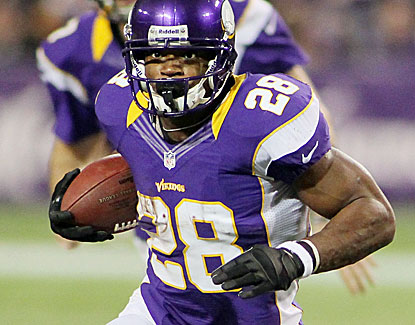Adrian Peterson rushes for 199 yards on a career-high 34 carries against a Packers defense designed to stop him. (Getty Images)