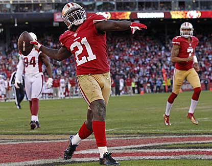 49ers running back Frank Gore tosses the ball into the stands after scoring a touchdown. (US Presswire)