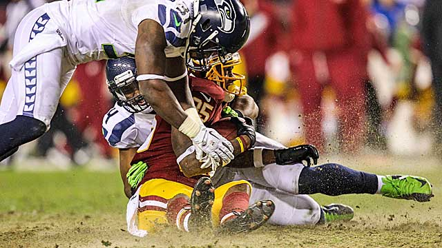 Dirt was flying Sunday in the Seahawks' win over the Redskins on the patchy turf at FedEx Field. (US Presswire)