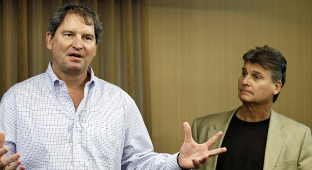 Bernie Kosar (left), pictured with Dr. Rick Sponaugle, says his symptoms are going away. (AP)