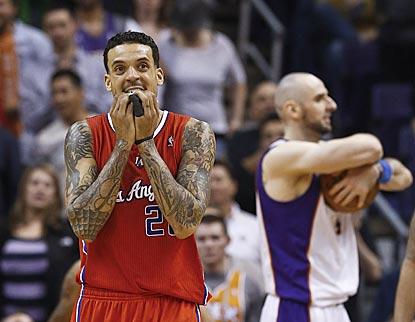 Matt Barnes seems bewildered that the Clippers have lost three in a row. Marcin Gortat (background) senses a Suns victory.  (AP)