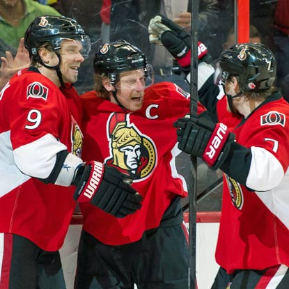 Daniel Alfredsson (middle) scores his first goal of the season to help propel the Senators past the Canadiens.  (US Presswire)