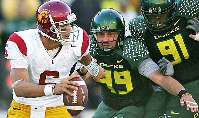 As Mark Sanchez (left) can tell you, Nick Reed (center) was a pass-rushing terror as a Duck. (USATSI)