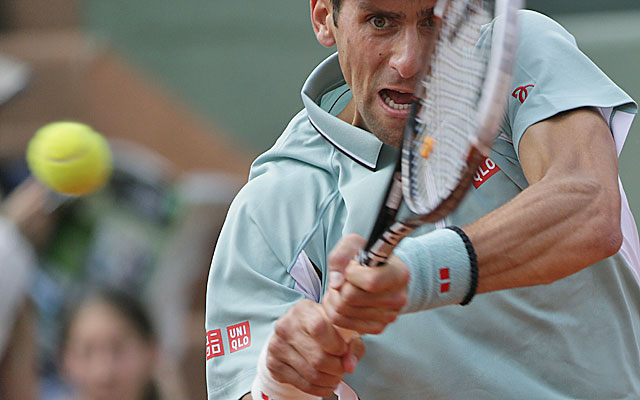 Djokovic keeps alive his pursuit of the only major he's yet to win. (Getty Images)
