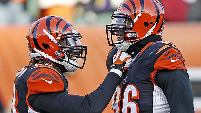Michael Johnson (left) and Carlos Dunlap (right) are unlikely to be teammates after this season. (USATSI)