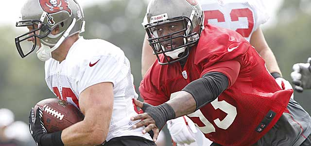 A slimmer Gerald McCoy gets after the QB early at training camp. (USATSI)