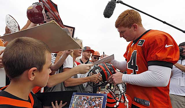 Andy Dalton signs autographs at camp. Is he good enough to do this at a Super Bowl? (USATSI)