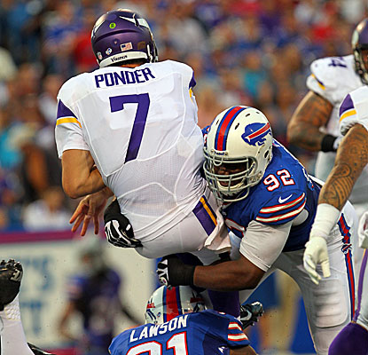Vikings QB Christian Ponder is sacked by Bills DE Alex Carrington, one of two sacks Ponder suffers in the game.  (USATSI)