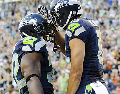 Seattle's Jermaine Kearse (right) celebrates one of his two touchdowns in the Seahawks' 40-10 win over Denver. (USATSI)